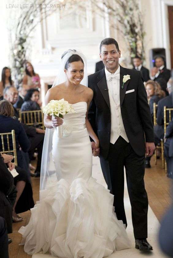 insey Davis walks down the aisle with her husband, Paul Roberts